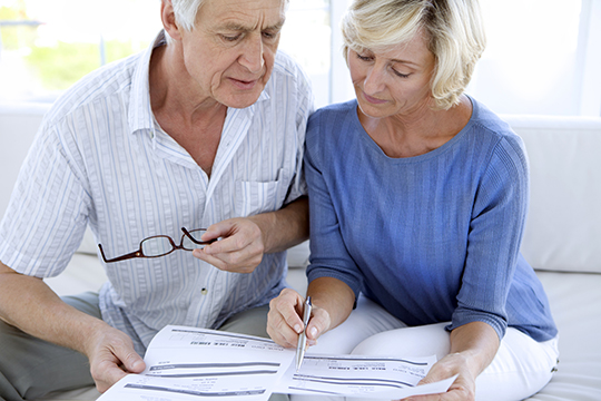 Senior couple doing home finances.