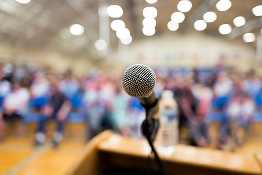Microphone on a podium in an auditorium.