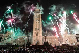 Pyrotechnics explode in front of Centre Block on Parliament Hill during the launch of Christmas Lights Across Canada, on Wednesday, Dec. 7, 2016, in Ottawa.