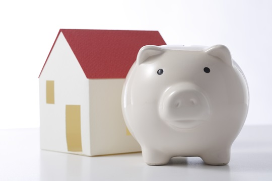Piggy bank with house