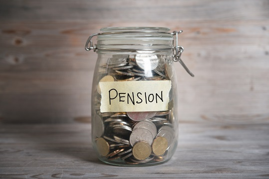 A money jar labelled with the word pension on it.
