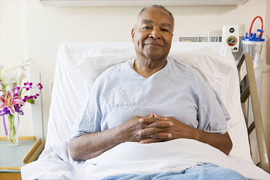 Senior man in a hospital bed