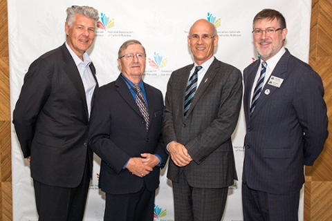 AMM Keynote Address.  From left to right: Andrew McGillivary, Director of Communications and Marketing; Jean-Guy Soulière, President; Michael Wernick, Clerk of the Privy Council of Canada; Simon Coakeley, CEO.